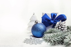 Christmas decorations lying on a light background. Copy space.