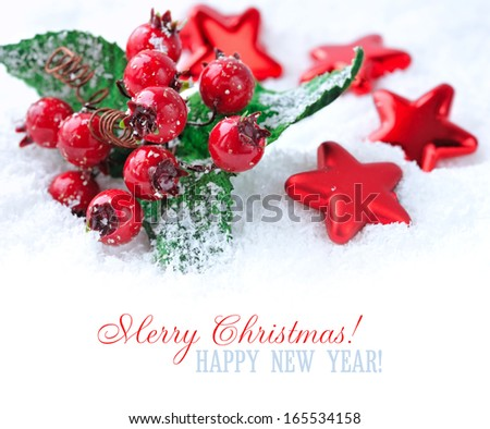 Christmas decorations of bauble are with stars on snow with sample text