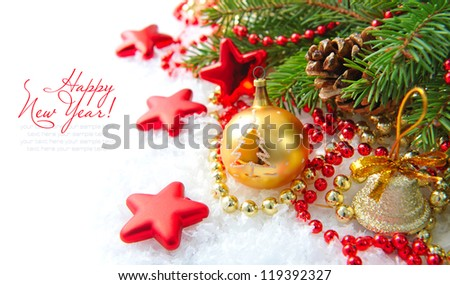 Christmas decorations of bauble are with the branches of fir on snow