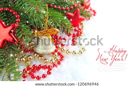 Christmas decorations of bauble are with the branches of spruce on snow
