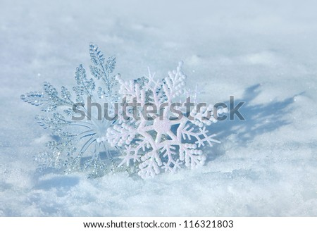 Christmas decorations on a snow background of nature