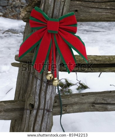 Christmas Decorations On An Old Wooden Fence Outside In The Snow - stock photo