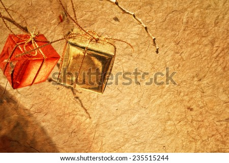 Christmas decorations on dried tree in mulberry paper texture style for background