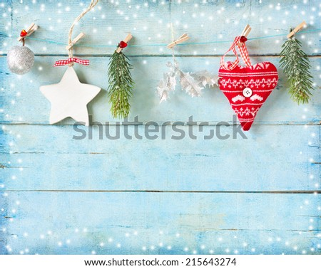 Stock Photo Christmas decorations on old blue wood background with copy space for congratulation.