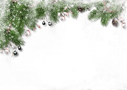 Christmas decorations on snowy wooden  background. border with fir branches, red berries and cones. Copy space