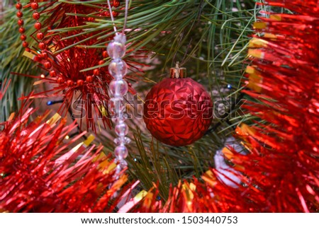 Christmas decorations on the Christmas tree in red  colors  close-up. Christmas decorations on the Christmas tree in red.