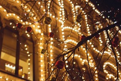 Christmas decorations on the street, colorful holiday bokeh lights, city night illumination, abstract blurry festive background