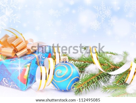 Christmas decorations over blue snowflakes background