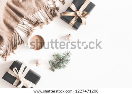 Christmas decorations, plaid, fir tree branch, gifts, cup of coffee on white background. Christmas, new year, winter concept. Flat lay, top view, copy space