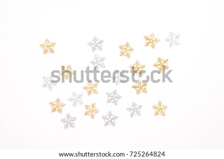 Christmas decorations,  silver snowflakes and gold snowflakes on white background. #725264824