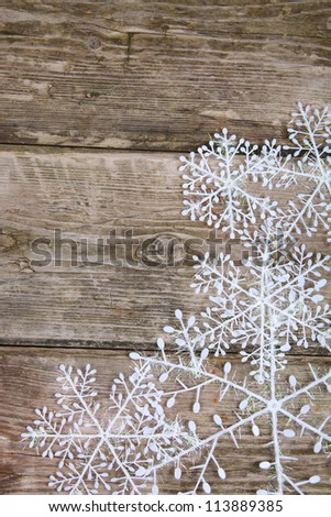 Christmas decorations (snowflake) on a wooden background