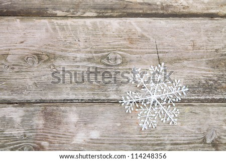 Christmas decorations, snowflake on a wooden background