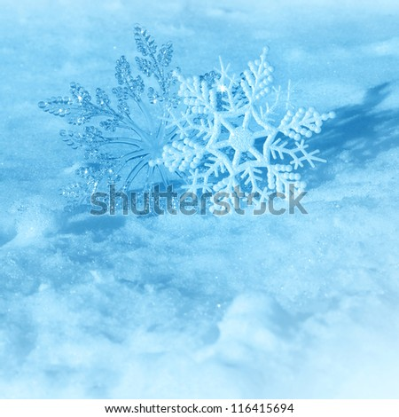 Christmas decorations  snowflakes on a snow background of nature