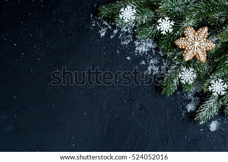 Christmas decorations, spruce branches on dark background top view