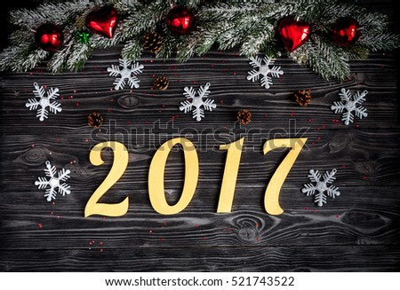 Christmas decorations, spruce branches on dark wooden background top view #521743522