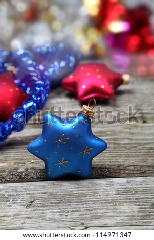Christmas decorations. Stars and garland on a wooden background