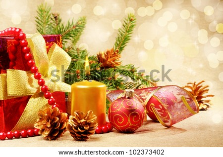 Christmas decorations with gift box over golden background