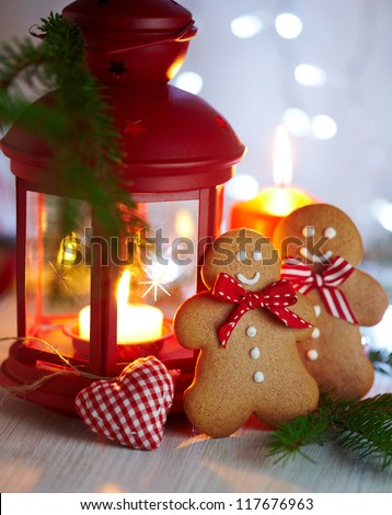 Christmas Decorations with Gingerbread man, lamp with candle and christmas baubles - stock photo