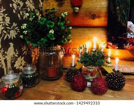 Christmas decorations with lanterns near the wooden wall