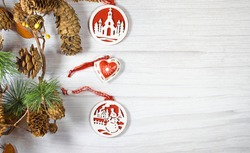 Christmas decorations with pineapple garland on a light background and space for designers.Wooden decorations in red and white