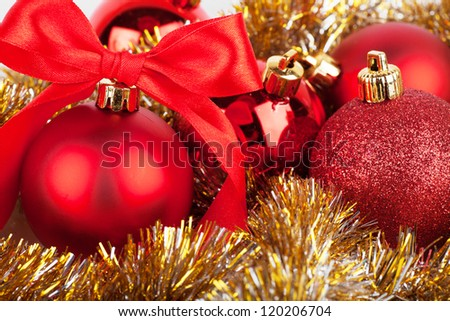 Christmas decorations with red bow and yellow tinsel