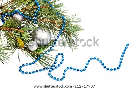 Christmas decorations with silver balls and blue beads on white background