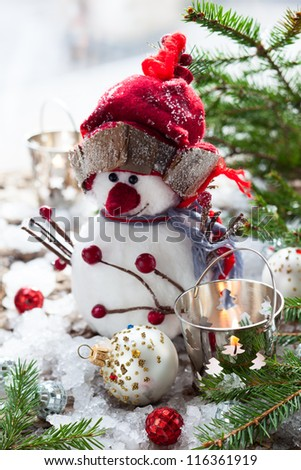 Christmas Decorations with snowman,candles and christmas baubles