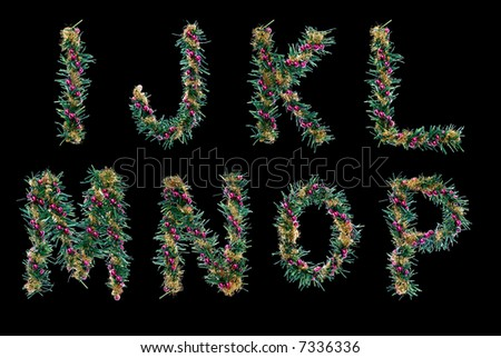 christmas decorative alphabet. letters. fir branches, red balls and golden tinsel. isolated.