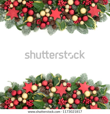 Christmas decorative background border with red and gold bauble decorations, holly berries, spruce pine, ivy, pine cones and mistletoe on white with copy space. #1173021817