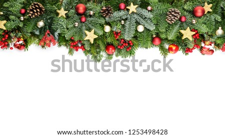 Christmas decorative background border with red bauble decorations, holly berries, spruce and pine cones #1253498428