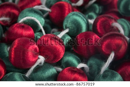 christmas decorative red and green baubles on string