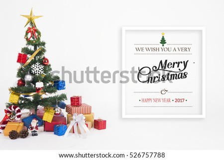 Christmas decorative with gift box and snowflake on christmas tree and Merry Christmas and Happy New Year 2017 text on white background.