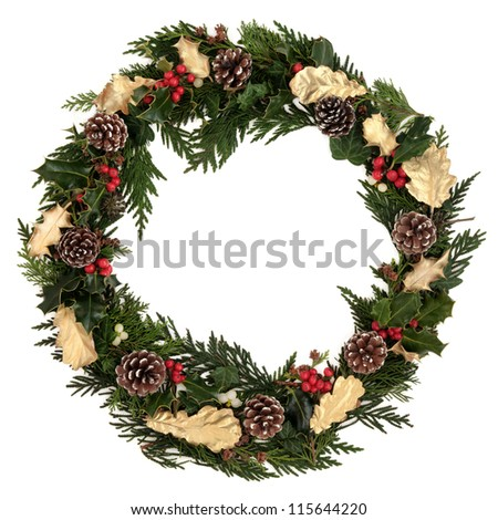Christmas decorative wreath of natural and golden oak and holly, ivy, mistletoe, cedar leyland leaf sprigs, pine cones over white background.