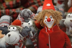 Christmas deer and funny clown. Toy in a warm red hat. Christmas toys for the interior in the house. Winter holidays New Year. Holiday is coming. Ideas To Capture the Festive Mood of The Winter Season