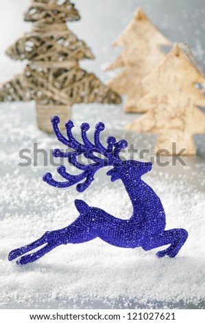 Christmas deer running in sunny snowing forest