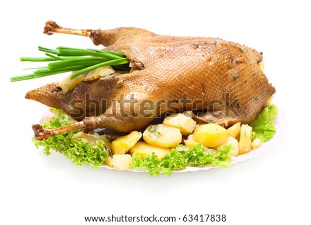 Christmas dinner goose baked with vegetables isolated on white