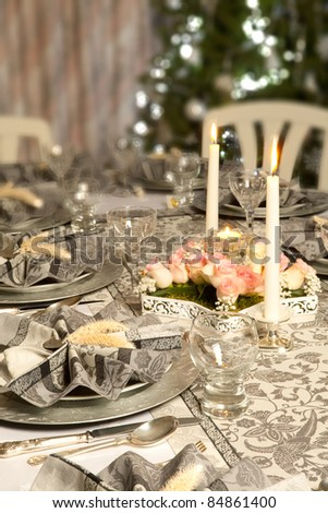 stock photo Christmas dinner table with decorated napkins and flower