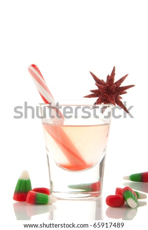 Christmas drink with cane and candies decorated with ornament on a white background
