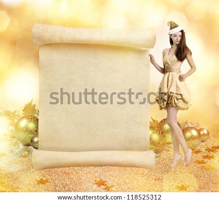 Christmas elf. Young gorgeous women as christmas elf on golden background with blank scroll
