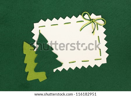 Christmas empty postcard  and new year trees on green background