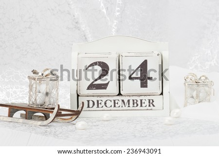 Christmas Eve Date On Calendar. December 24. Christmas Decorations. Gift Box On Sleigh. Sweets.