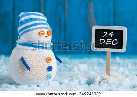 Christmas Eve Date On sign. December 24. Snowman near direction Sign. Xmas Decorations #349241969