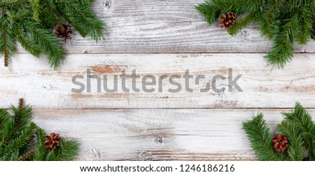 Christmas Evergreen branch decorations in all corners on white vintage wood #1246186216