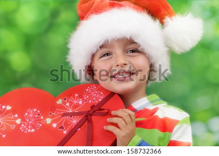 Christmas excitement - ecstatic young boy on christmas morning holding a present