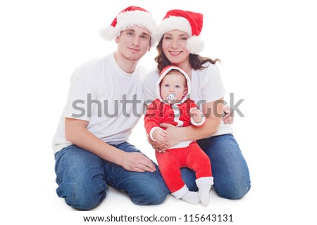 christmas family looking at camera and smiling. isolated on white background
