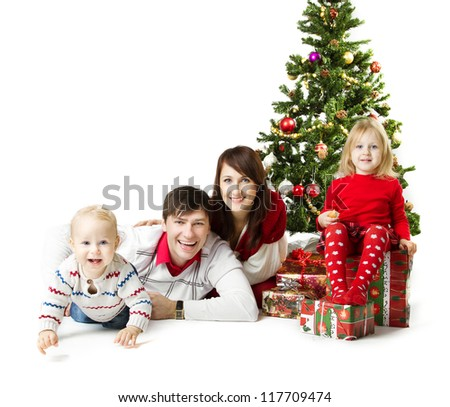 Christmas family of four persons and fir tree with gift boxes