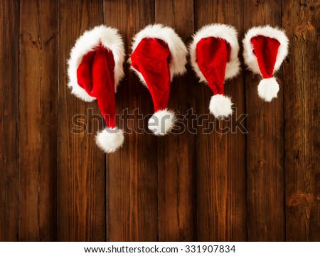 Christmas Family Santa Claus Hats Hanging on Wood Wall, Xmas Kid Hat Hang on Decorated Background