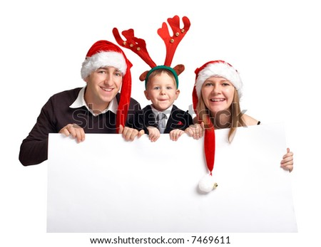 Christmas family with banner. Happy family of three in Christmas hats holds white banner