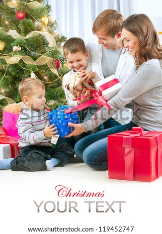 Christmas Family with Kids. Happy Family Opening Gift. Christmas tree