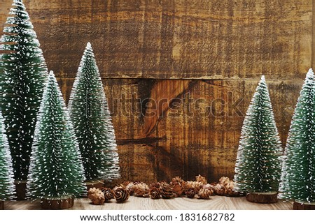 Christmas Festive background concept decoration with Christmas tree and pine cones on wooden background Photo stock ©